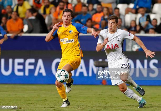Apoel FC's Argentine midfielder Agustin Farias is marked by Tottenham Hotspur's English midfielder Harry Winks during the UEFA Champions League...