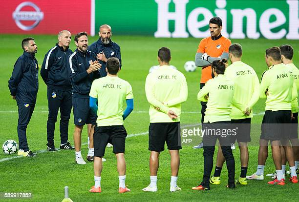 Apoel FC's head coach Thomas Christiansen talks to players during a training session in Copenhagen on August 15 2016 on the eve of the Champions...