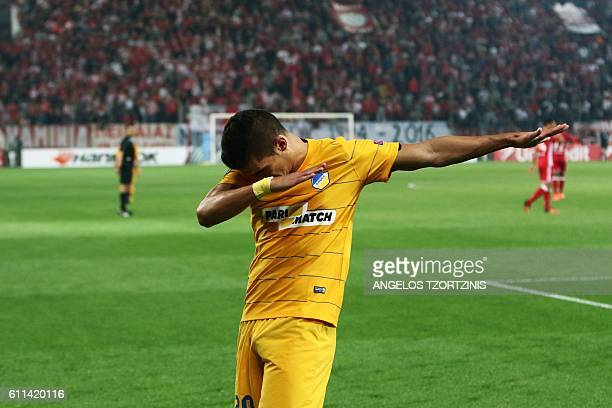 Apoel Nicosia' Cypriot Pieros Sotiriou celebrates after scoring his first goal during the UEFA Europa League group football match between Olympiacos...