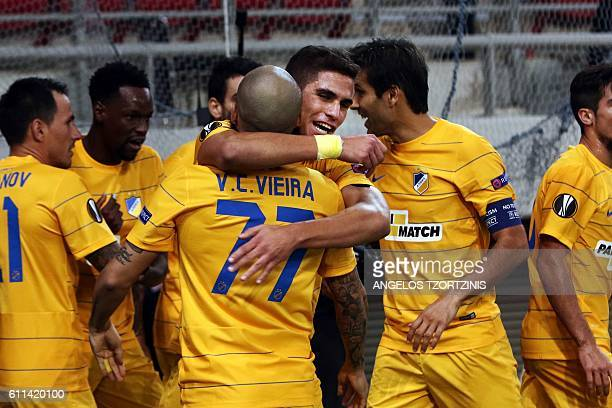 Apoel Nicosia' Cypriot Pieros Sotiriou celebrates with teammates after scoring his team's first goal during the UEFA Europa League group football...