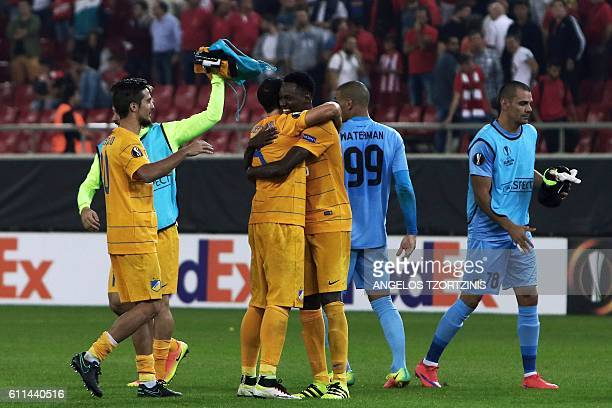 Apoel Nicosia' players celebrate after the winning the UEFA Europa League group B football match between Olympiacos FC and Apoel Nicosia on September...
