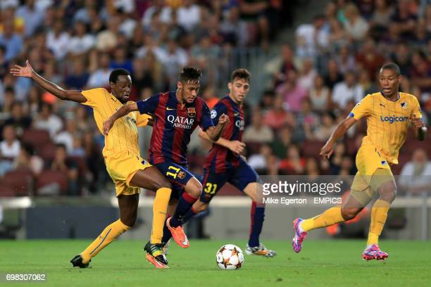 Apoel Nicosia's Franco Vinicius and Barcelona's Junior Neymar battle for the ball