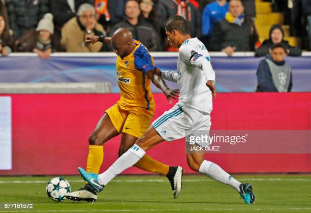 Apoel's Beninese forward Mickael Pote views for the ball against Real Madrid's French defender Raphael Varane during the UEFA Champions League Group...