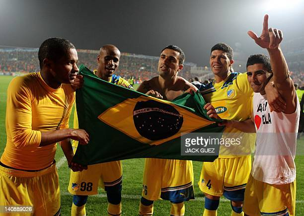 Apoel's Brazilian players Marcinho William Boaventura Marcelo Oliveira Kaka and Ailton hold their national flag as they celebrate their team's win...
