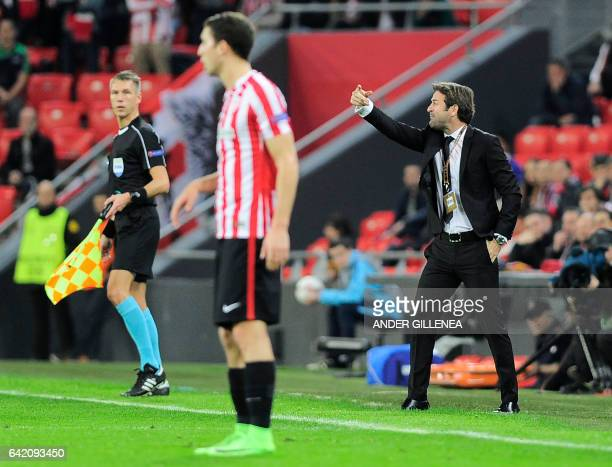 Apoel's coach Thomas Christiansen gives instructions to players during the Europa League football match Athletic Club Bilbao vs APOEL Nicosia at the...