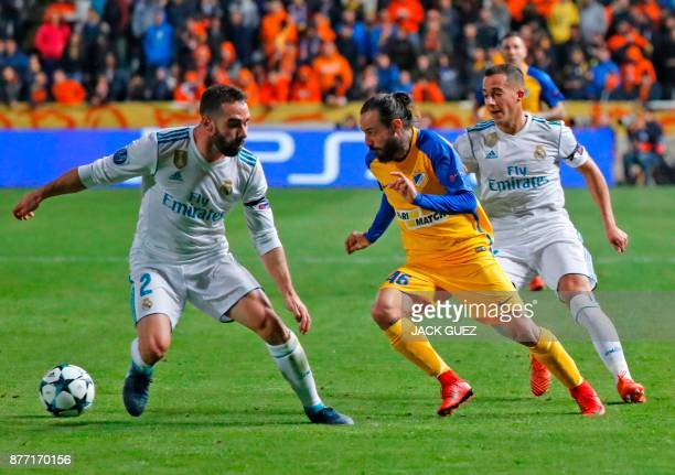 Apoel's Cypriot midfielder Efstathios Aloneftis views for the ball with Real Madrid's Spanish defender Dani Carvajal during the UEFA Champions League...