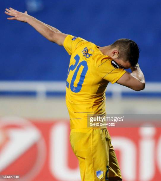 Apoel's Cypriot striker Pieros Sotiriou celebrates his goal and his team's opening goal during the Europa League football match between APOEL Nicosia...