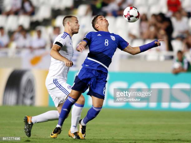 Apoel's Cypriot striker Pieros Sotiriou vies for the ball against Bosnia and Herzegovina player during their World Cup 2018 Europe qualifying match...