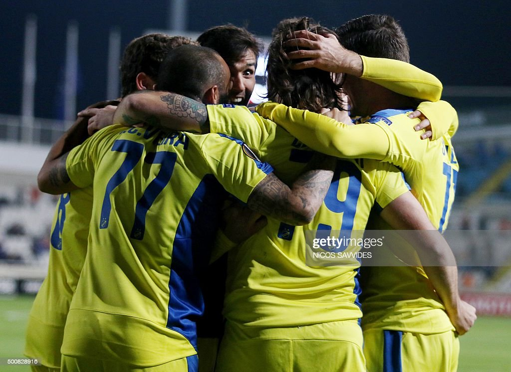 Apoel's Fernando Cavenaghi celebrates with teammates after scoring a goal during the UEFA Europa League football match Cyprus' Apoel FC versus Czech...