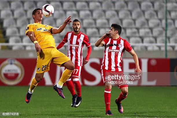 Apoel's forward Pieros Sotiriou chests the ball as he is marked by Olympiacos' forward Tarik Elyounoussi during the Europa League Group B football...