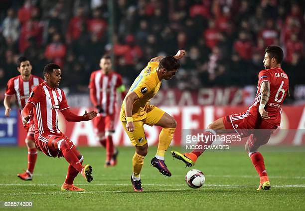 Apoel's forward Pieros Sotiriou dribbles past Olympiacos' defender Manuel Da Costa during the Europa League Group B football match between Cyprus'...