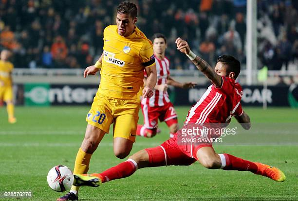 Apoel's forward Pieros Sotiriou is tackled by Olympiacos' defender Manuel Da Costa during the Europa League Group B football match between Cyprus'...