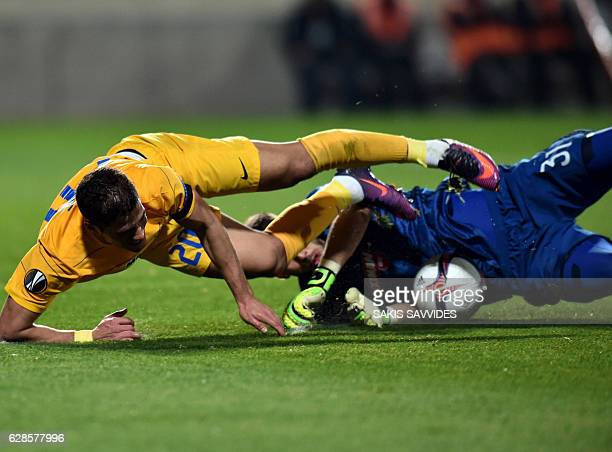 Apoel's forward Pieros Sotiriou vies for the ball with Olympiacos' goalkeeper Nicola Leali during the Europa League Group B football match between...