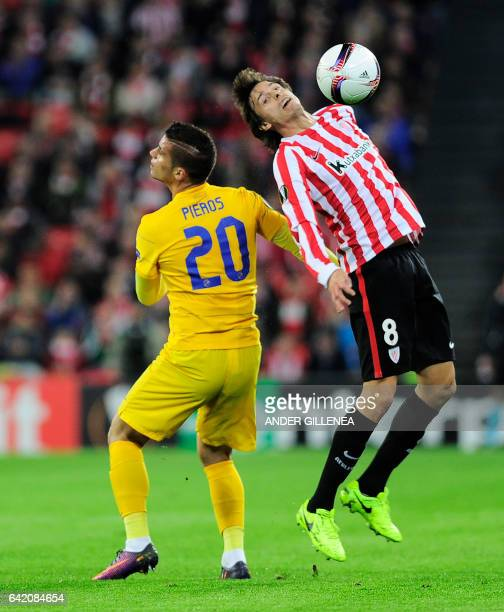 Apoel's forward Pieros Sotiriou vies with Athletic Bilbao's midfielder Ander Iturraspe during the Europa League football match Athletic Club Bilbao...