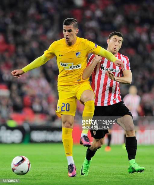Apoel's forward Pieros Sotiriou vies with Athletic Bilbao's midfielder Oscar de Marcos during the Europa League football match Athletic Club Bilbao...