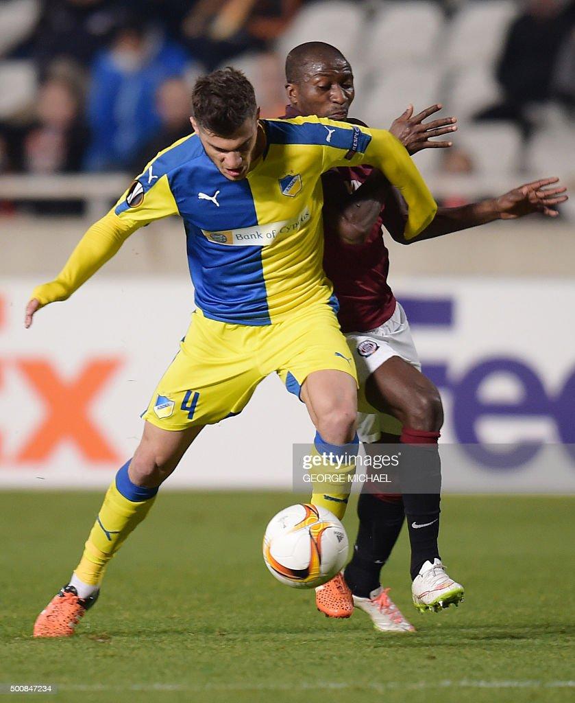Apoel's Kostakis Artymatas controls the ball during the UEFA Europa League football match Cyprus' Apoel FC versus Czech Republic's AC Sparta Praha at...