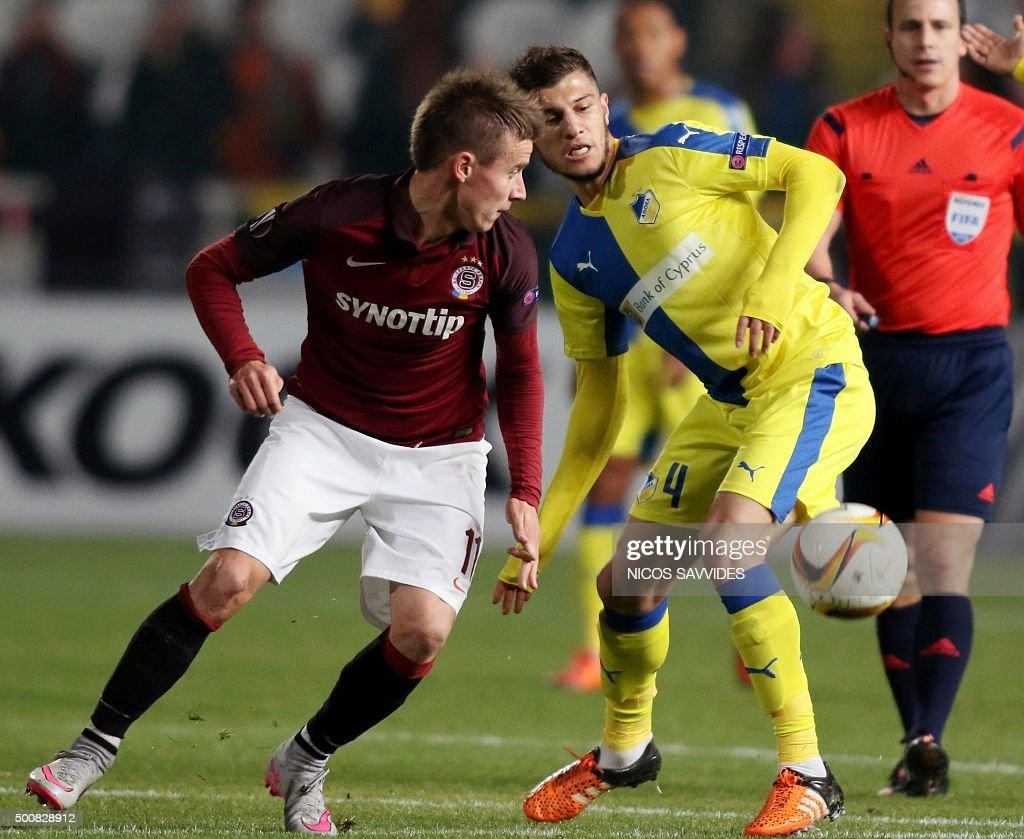Apoel's Kostakis Artymatas vies with Sparta's Lukas Marecek during the UEFA Europa League football match Cyprus' Apoel FC versus Czech Republic's AC...