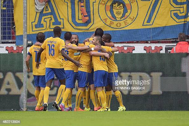 Apoel's players celebrate after scoring during the European Champion League third round qualifying match between FC Midtjylland and Apoel FC at the...