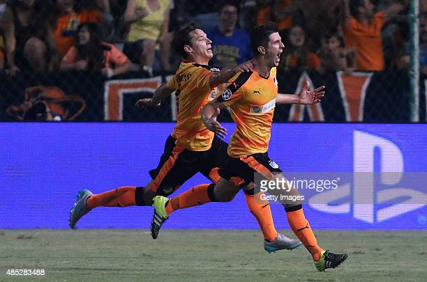 Apoel's Semir Stilic and team mate Tomas De Vincenti celebrate a goal during UEFA Champions League play off between APOEL Nicosia and FC Astana at...