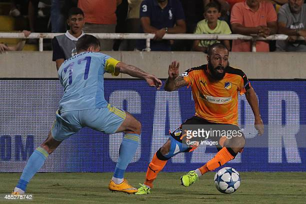 Apoel's Vander and FC Astana's Dmitri Shomko in action during UEFA Champions League play off between APOEL Nicosia and FC Astana at GSP Stadium on...
