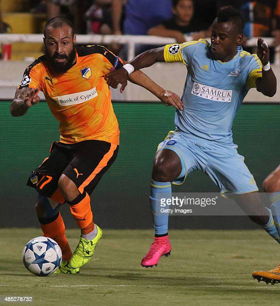 Apoel's Vander and FC Astana's Foxi Kethevoama in action during UEFA Champions League play off between APOEL Nicosia and FC Astana at GSP Stadium on...
