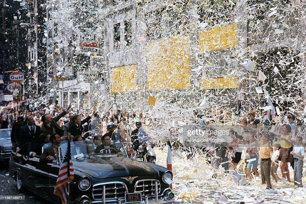 Apollo 11 American astronauts Neil Armstrong Michael Collins and Buzz Aldrin warm welcomed by the crowd after the mission that brought them on the...