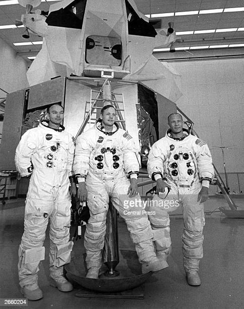 Apollo 11 astronauts Mike Collins Neil Armstrong and Edwin 'Buzz' Aldrin in front of the Lunar Landing Module Simulator at the Kennedy Space Centre...