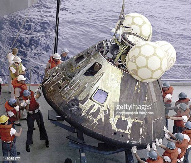 Apollo 13 Command Module Crewmen Hoist The Apollo 13 Command Module Odyssey Aboard The USS Iwo Jima The Spacecraft Splashed Down At 120744 PM April...