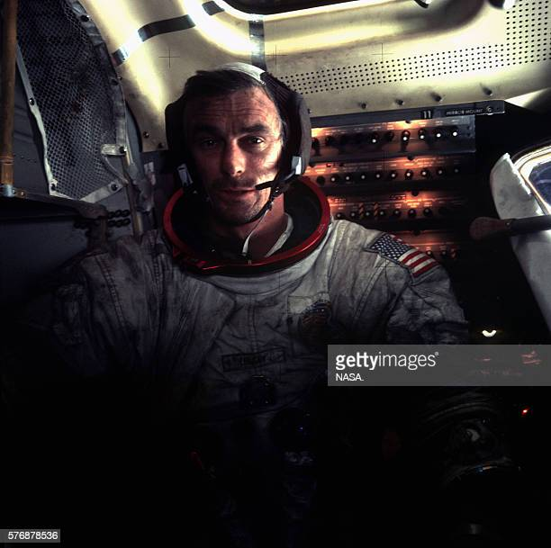 Apollo 17 astronaut Eugene Cernan sits in the dimlylit Apollo 17 lunar module on the surface of the Moon | Location TaurusLittrow Valley Moon