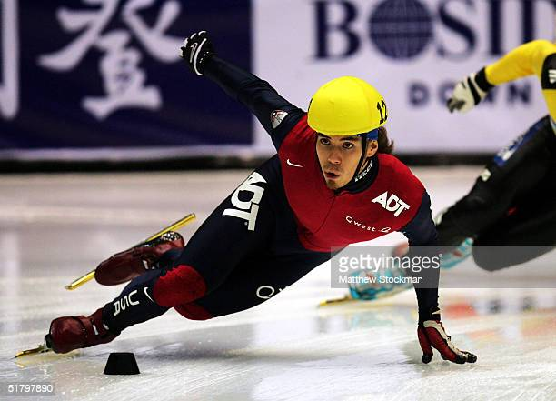 Apollo Anton Ohno competes in the semifinals of the 500 meter event November 27 2004 during the Bosideng ISU World Cup at the Alliant Energy Center...