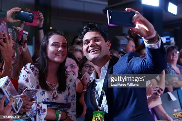 Apollo Jackson takes photos with fans during the Australian Premiere of Thor Ragnarok on October 13 2017 in Gold Coast Australia