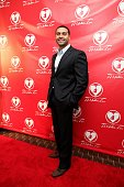 Apollo Nida from Bravo's 'Real Housewives Of Atlanta' poses for red carpet photos for 'A Mother's Love' stage play at the Rialto Center For The Arts...