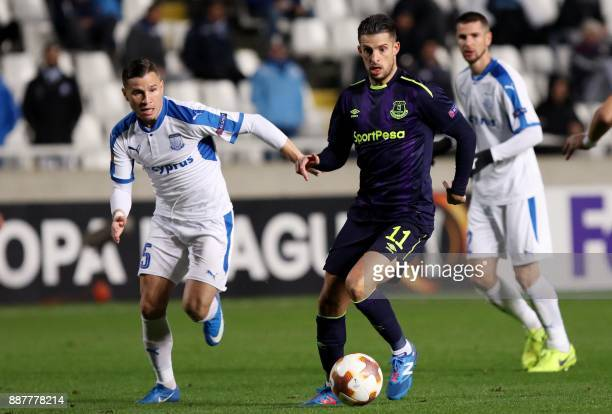 Apollon Limassol's Esteban Sachetti fights for the ball against Everton's Kevin Mirallas during the UEFA Europa League group stage football match...