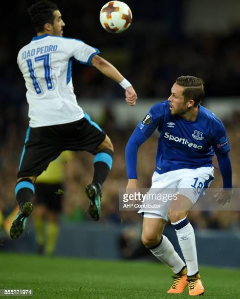 Apollon Limassol's Portuguese midfielder Joao Pedro vies with Everton's Icelandic midfielder Gylfi Sigurdsson during the UEFA Europa League Group...