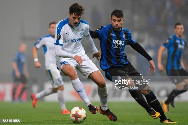 Apollon Limassol's Spanish defender Hector Yuste vies with Atalanta's Italian forward Andrea Petagna during the UEFA Europa League group E football...