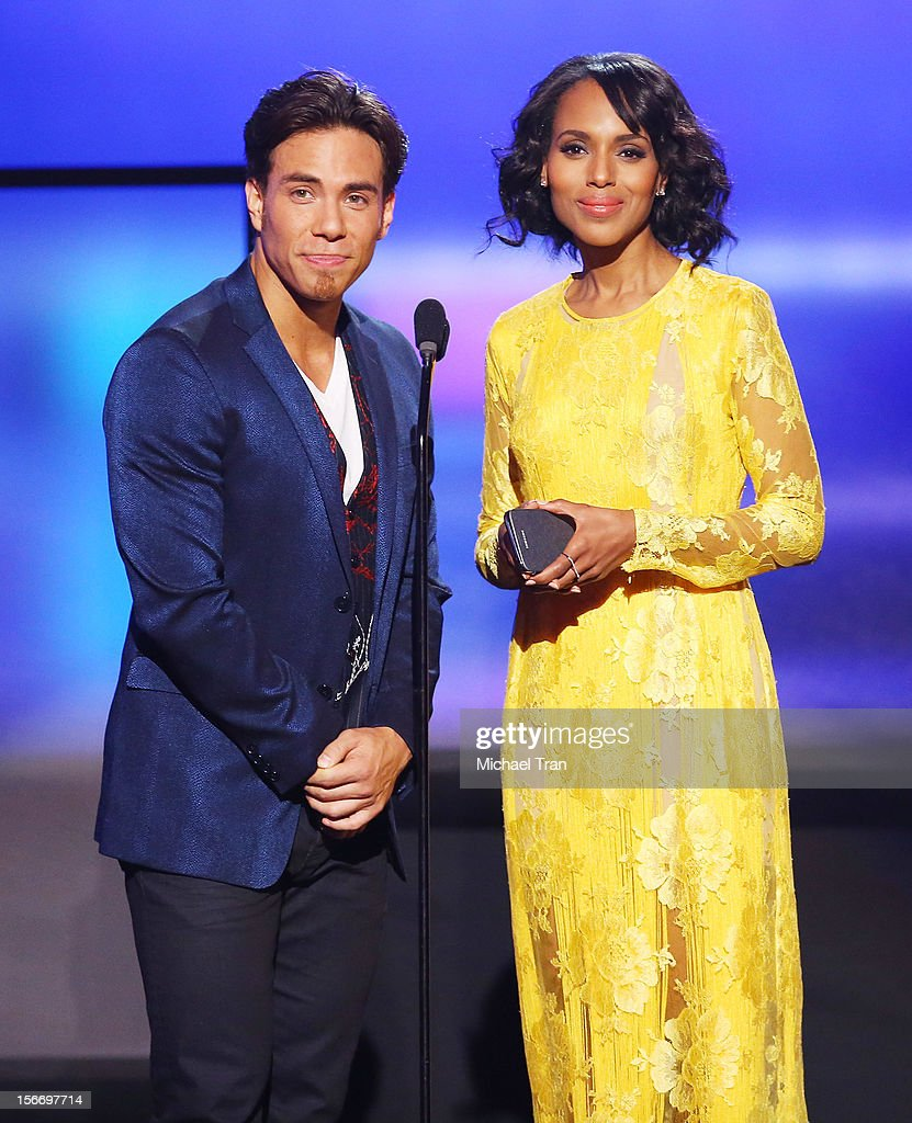 Apolo Anton Ohno (L) and Kerry Washington speak onstage at The 40th American Music Awards held at Nokia Theatre L.A. Live on November 18, 2012 in Los Angeles, California.
