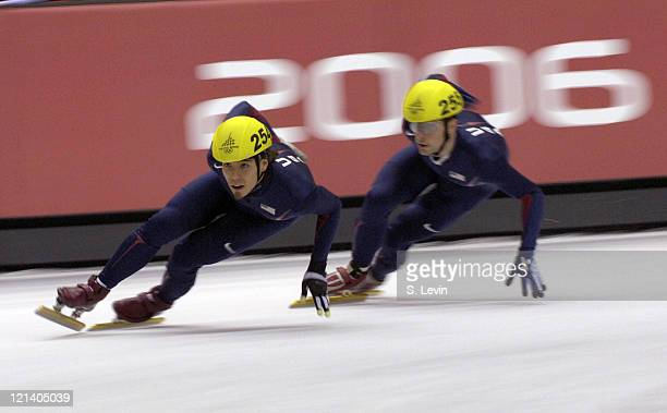 Apolo Anton Ohno and Rusty Smith of the United States in action during the Men's Short Track 1000 m at the Palavela during the 2006 Olympic Games in...