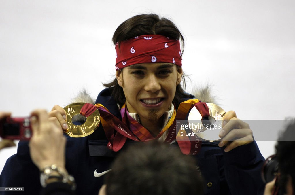 Apolo Anton Ohno of the United States celebrates winning a gold and bronze medal during the Short Track Speed Skating 500 m and 5000 m Relay at the...