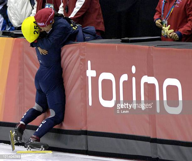 Apolo Anton Ohno of the United States celebrates winning a gold medal during the Short Track Speed Skating 500 m at the 2006 Olympic Games held at...