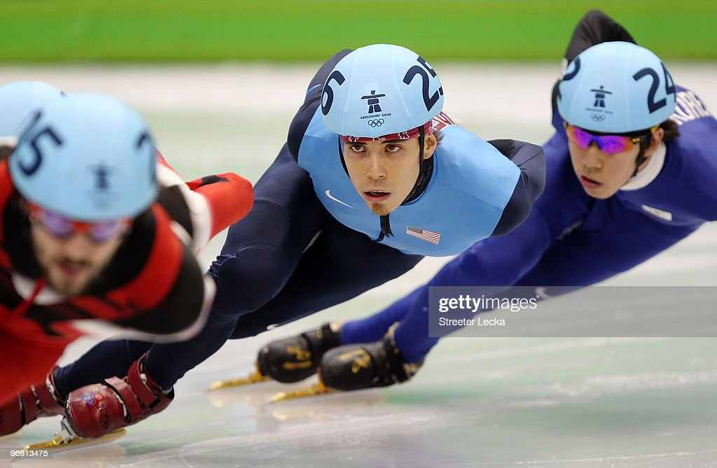 Apolo Anton Ohno of the United States competes on his way to winning the bronze medal during the Short Track Speed Skating Men's 1000m Final on day 9...
