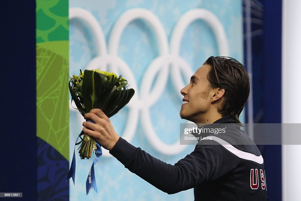 <a gi-track='captionPersonalityLinkClicked' href=/galleries/search?phrase=Apolo+Anton+Ohno&family=editorial&specificpeople=213110 ng-click='$event.stopPropagation()'>Apolo Anton Ohno</a> of the United States reacts to winning the bronze medal during the flower ceremony for the men's 1000 m short track speed skating on day 9 of the Vancouver 2010 Winter Olympics at Pacific Coliseum on February 20, 2010 in Vancouver, Canada.
