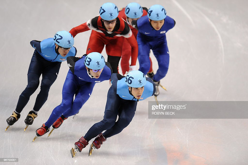 Apolo Anton Ohno (R) of the US is pursued by South Korean Jung-su Lee (2nd L) and J.R. Celski of the US in the men's 1,500 m short-track final at the Pacific Coliseum in Vancouver on February 13, 2010 during the 2010 Winter Olympics. AFP PHOTO / Robyn BECK