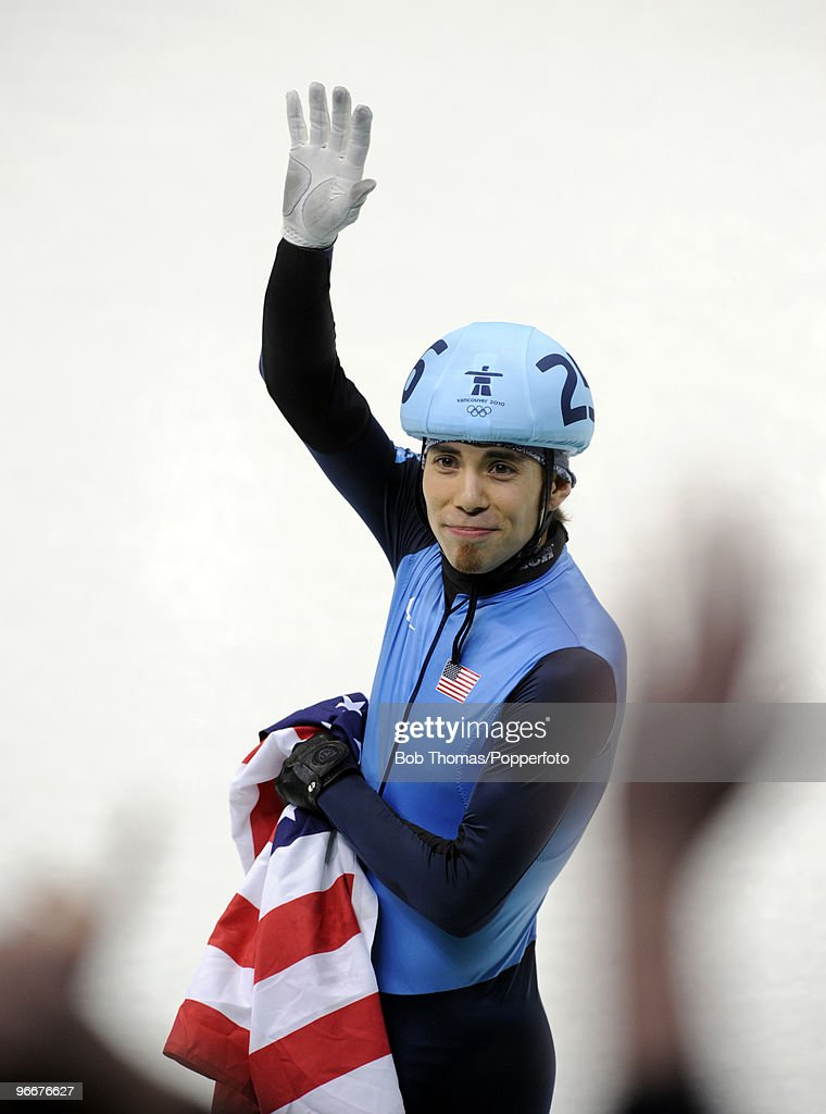Apolo Anton Ohno of United States celebrates after winning the silver medal in the Men's 1500 m Short Track finals on day 2 of the Vancouver 2010 Winter Olympics at Pacific Coliseum on February 13, 2010 in Vancouver, Canada.