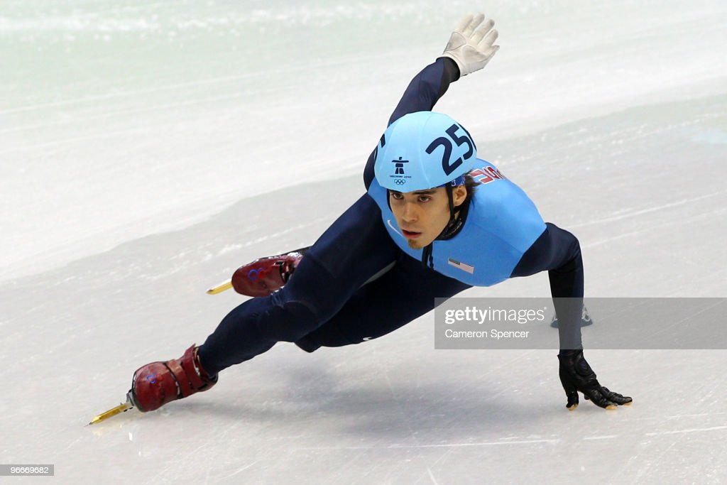 Apolo Anton Ohno of United States races during a heat of the men's 1500 m men's short track on day 2 of the Vancouver 2010 Winter Olympics at Pacific...