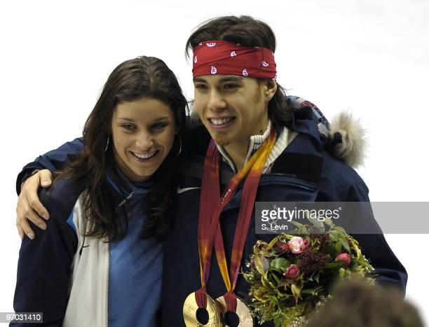 Apolo Anton Ohno's teammate US Speedskater Allison Baver enjoys the moment with Ohno during the Short Track Speed Skating 500 m at the 2006 Olympic...