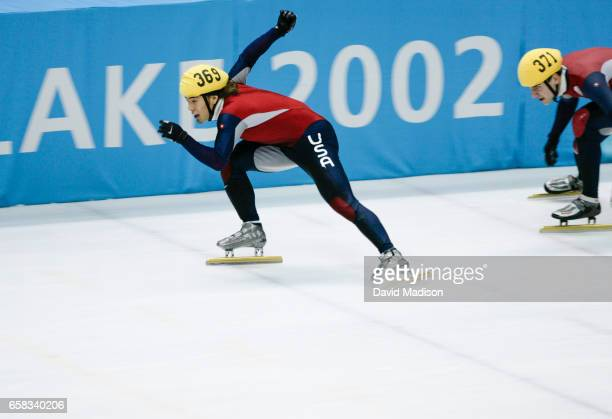 Apolo Ohno of the USA starts to skate following an exchange from teammate Daniel Weinstein during the Men's 5000 meter Relay of the Short Track speed...