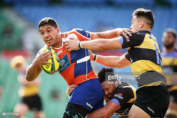 Apolosi Latunipulu of the Rams is tackled during the round three NRC match between the Western Sydney Rams and the Perth Spirit at Concord Oval on...
