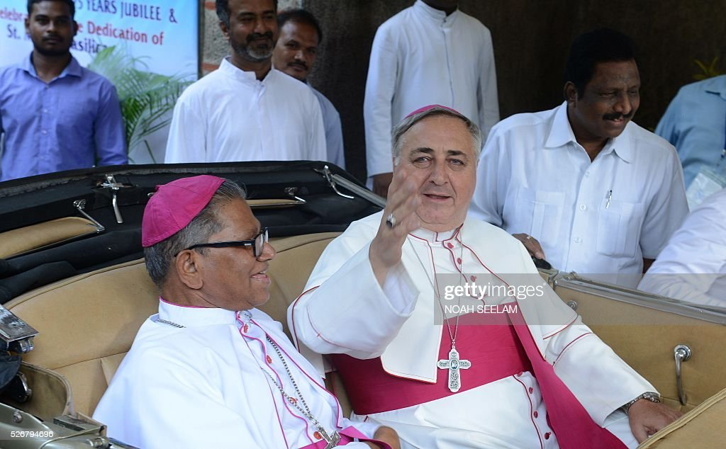 Apostolic Nuncio to India The Most Reverend Salvatore Pennacchio(R)waves as he sits alongside Archibishop of Hyderabad Reverend Thumma Bala as they proceed in a vehicle to participate in the 175 year (Quartoseptcentennial) jubilee celebrations of Saint Mary's Basilica in Secunderabad, the twin city of Hyderabad on May 1, 2016. Saint Mary's Basilica was built in 1840, and has been raised to the status of minor Basilica, in the southern Indian states of Telangana and Andhra Pradesh. / AFP / NOAH