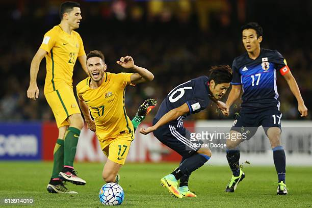 Apostolos Giannou of the Socceroos is tripped by Hotaru Yamaguchi of Japan during the 2018 FIFA World Cup Qualifier match between the Australian...