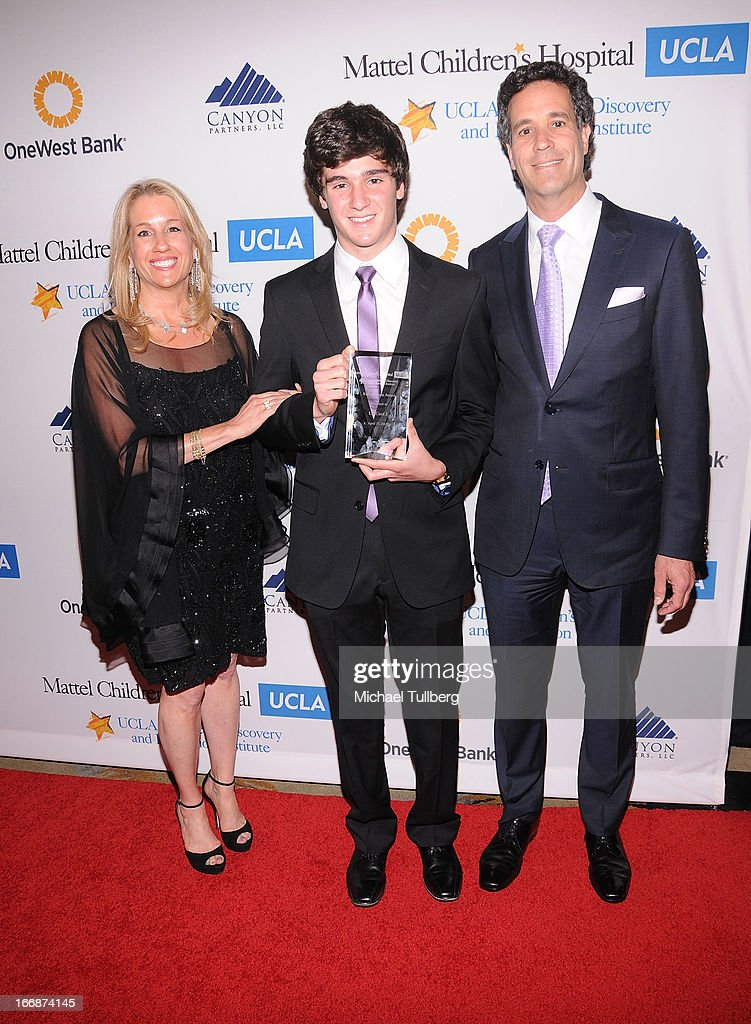 App designer Cameron Cohen (C) and his parents attend 'The Kaleidescope Ball' benefitting The UCLA Children's Discovery And Innovation at Beverly Hills Hotel on April 17, 2013 in Beverly Hills, California.
